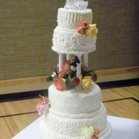Tiered Wedding Cake With Flowers   Marble wedding cake with crusting butter cream icing.