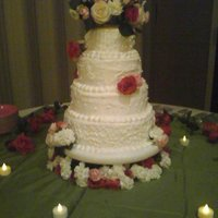 White Wedding With Fresh Flowers  Crusting white butter cream frosting with piping work on all four layers. The cake is strawberry cake mix with the extender recipe added (...