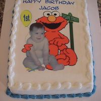 Elmo Yep..another sheet cake! I cropped a picture of Elmo and this baby and tried to make it look as though they were sitting together!!
