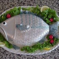 Something Fishy.. Inspired from a cake in Colette Peters' book. Sculpted cake, covered with fondant. Painted with Luster Dust. Fondant cherry tomatoes....