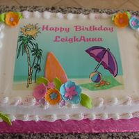 Luau Birthday Sheet cake made to match the paper party plates. It is a combination of an edible image and MMF for the flowers and surfboard.