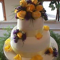Small Fondant   This is a ten + six fondant cake with fresh flowers for a small reception.