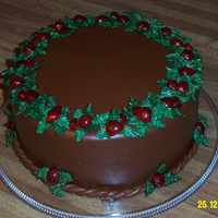 Christmas Wreath 2009  Devils food, iced and filled with chocolate keoke coffee buttercream, covered with from-scratch buttery chocolate MMF, trimmed with...
