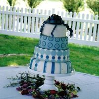 Periwinkle   This is my first cake, it is chocolate with raspberry filling, chocolate butter cream, choclate ganache and fondant.
