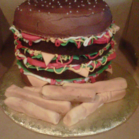 Burger And Fries triple decker cheeseburger made with chocolate cake. Fries were vanilla cake with fondant. First time using my airbrush.