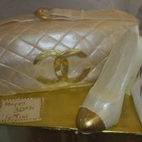 Chanel Purse And Shoe The cake was done with white chocolate fondant and the shoe is solid white chocolate. Both were highlighted with luster dust