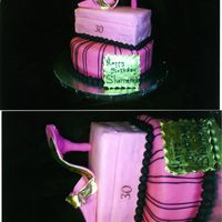 Jimmy Choo Gumpaste full size shoe atop acake shoe ox and cake. The client wanted Hot pink and black.