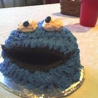 "Cookie Monster Cake 1st cake for a little boy. Blue butter cream and the black and white icing is ""Bettercream""."