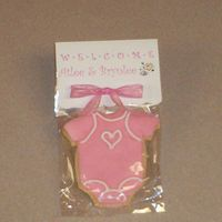 Onesie Cookies I made these for a friend who is having identical twin girls. Rolled buttercream with royal icing accents on sugar cookie