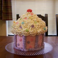 "Tessaa's Cupcake Big cupcake. I did one with the wilton cupcake pan, and this one using 6"" pans and a bowl for the top. I did not like the way the..."