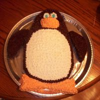 Penguin Cake My son requested a penguin cake for his 3rd birthday. I made it from two rectangle cakes cut to shape. Covered it in vanilla and chocolate...