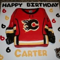 Calgary Flames Jersey Cake My son wanted a Calgary Flames birthday so I saw a picture on here of a different jersey and decided to change it to a Flames Jersey. i...