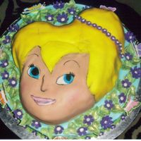 Tinker Bell Again SHAPED PAN ON ROUND CAKE COVERED IN FONDANT, PAINTED EYES AND MOUTH,FONDANT FLOWER, FONDANT LEAVES BRUSHED WITH GREEN LUSTER DUST,...