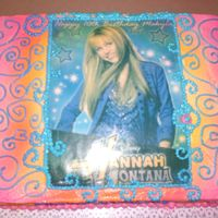 Cimg2104.jpg Edible image of Hanna Montana for a 10 yr old Birthday Party. BBC icing and edible spray. The stars are fondant. The cake was sitting out...