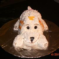 Cimg1725.jpg puppy sculpted cake, bbc icing w/fondant ears nose and eyes. I painted nose, eye, and paws with food coloring. I just wanted to do a...