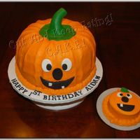 Jack O Lantern Birthday Surprise! Jack O Lantern cake made for a 1st birthday. French Vanilla bundt cakes(2) covered and filled with vanilla buttercream tinted orange. Faces...
