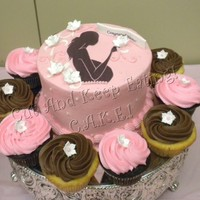 "Pink & Brown Babyshower W/ Cuppies 6"" Chocolate cake filled with buttercream surrounding by a few of the 50 cupcakes that were made. Cupcakes were 1/2 chocolate and 1/2..."