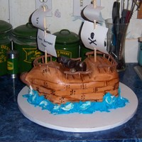 Pirate Ship Chocolate fudge cake with BC and MMF. Cannon, treasure chest and railing were done with a MMF/modeling chocolate mixture. TFL!