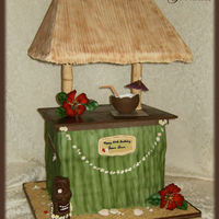 "Tiki Bar 28"" Tall with gumpast flowers, chocolate shells, gumpaste coconut drink filled with piping gel ""drink""."