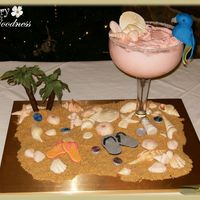 "Margaritaville Theme Grooms Cake Glass contains a 6"" Strawberry Margarita Cake with Strawberry-Lime Buttercream. The parrot is hand molded, salt shaker, chocolate..."