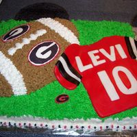 Footbal Cake customer wanted football with Georgia. all buttercream with fondant accents.