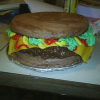 My First Cheeseburger Cake! my first ever cheeseburger cake! took some time, but it was awesome!! the bun looks more like sourdough tho haha.