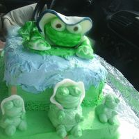Frog Baby Shower Cake the little frogs in front are made from icing and the big frog on top is made from fondant.
