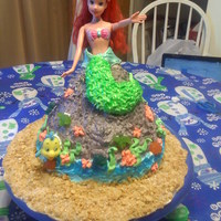 "Ariel my daughter request a ""Ariel on a rock"" cake for her birthday and this the result! she was THRILLED and i was relieved lol."