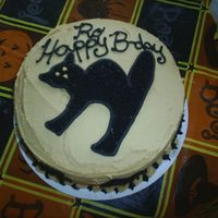 S4010232.jpg peanut butter cake w/ peanut butter icing. would have been better w/out the writing LOL