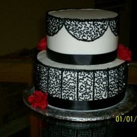 Black And White Wedding Small black and white wedding cake, looked better with the topper. All buttercream with silk flowers. Originally intended on striping the...