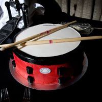 Snare Drum Cake This cake was made to be a replica of the grooms beloved custom made snare drum. It's a round cake with buttercream icing and fondant...