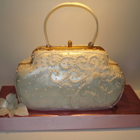 Handbag Cake White fondant with pearl luster dust. FV cake and filling