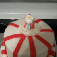 Top Of Christmas Cake RI santa on top of fondant cake (attached with buttercream).