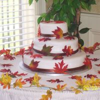 "Autumn Leaves Wedding Cake 14"", 10"" and 6"" cakes, lemon with raspberry filling and carrot with cream cheese filling... Covered in fondant with silk..."
