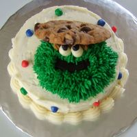 Oscar Oscar the grouch mini cake for my daughter's 2nd birthday. It had cupcakes for the kids to go with it.