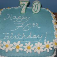Birthday Cake Made this for my mother in law's...well....70th! :) White cake with strawberry buttercream filling and BC with royal icing daisies....