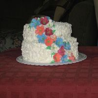 My First Paid Cake!   I enjoyed doing the royal icing flowers. They're petunias according to Michael's! lol