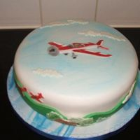 Airplanes I made for a friends dh, he loves airplanes, the cake is lemon cake with lemon buttercream, covered with fondant and using patchwork...
