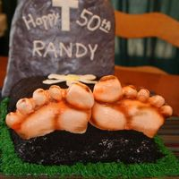 Over The Hill  This is a 1/4 sheet cake rounded with buttercream covered in crushed oreoa.The feet are made of MMF and airbrushed.The headstone is RK...