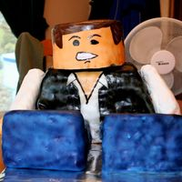 Lego Star Wars - Han Solo  This is a cake I did for my 3 year-olds b-day. The body is two 1/4 sheet cakes cut in 1/3rd's and stacked. Carved in a slightly...