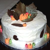 Fall Cake   Carrot Cake with Cream Cheese Frosting. Chocolate leaves, gum paste pumpkins and pears.