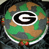 Georgia Hunter  This was a round cake with chocolate buttercream. It was a groom's cake that I made for a man that was a hunting fanatic and also love...