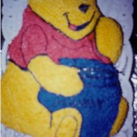 Winnie The Pooh  My SIL asked me to do this cake for her SIL's baby shower. I put real honey on the jar. Sorry for the blur, this is another one taken...