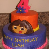 Dairy/egg/nut Free Dora   Egg, dairy, & nut free. 6 & 10 inch round. buttercream frosting. Fondant accents.