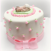 Girl Baby Shower Cake  Rich dark chocolate cake with fresh raspberry filling and dark ganache under the fondant. All fondant decorations. Baby is gum paste and...