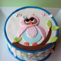 Owl On A Tree.   Applique style cake. Mango tango pound cake with citrus Swiss meringue butter cream. All fondant decorations.