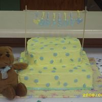 Yellow & Blue Baby Shower Cake  Yellow BC icing w/blue fondant circles. The letters are also blue fondant. All pieces on clothesline are from Wal-Mart. The air conditioner...