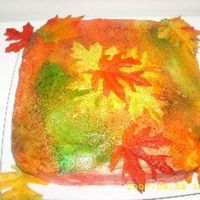First Day Of Fall  Butter cake with vanilla BC icing. Food color spray in fallish colors. The leaves are fake from a craft store. Sprinkles in matching colors...