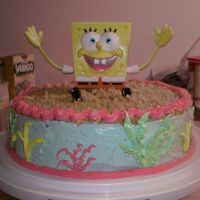 Sponge Bob Birthday Cake  Chocolate cake w/BC icing. Sponge Bob from Wal-Mart cake dept. I used crushed graham crackers on the top for the sand. Thanks for looking...