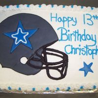 Dallas Cowboy Birthday Cake White cake with pineapple filling. Buttercream icing. Helemet is color flow and stars are made out of fondant. This is the first cake I...